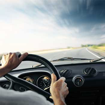 Image of patient driving a car.